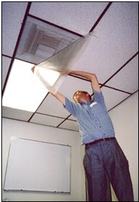 Person taping plastic sheeting over a vent to close airflow; Tape plastic sheeting over vents, windows, and doors to prevent contaminated air from entering the room