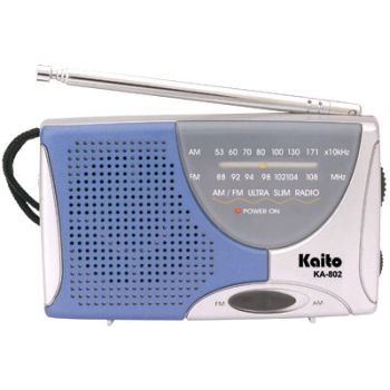 Ultra Compact AM/FM Radio/Telescopic Antenna/Speaker/Earphones/Strap--